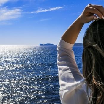 Tourist looking at Capo Caccia