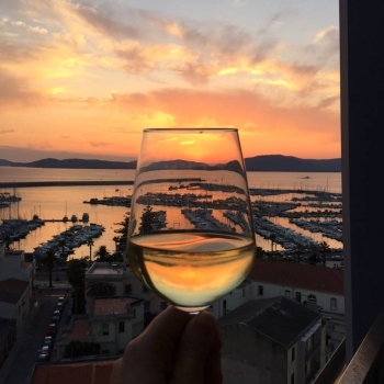 Colors of the sunset in a goblet of wine
