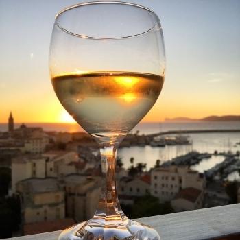 Reflex of Alghero in a glass of wine