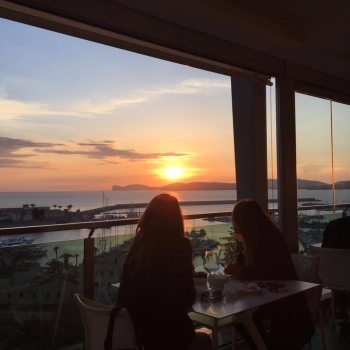 Bar's customers watch the sunset