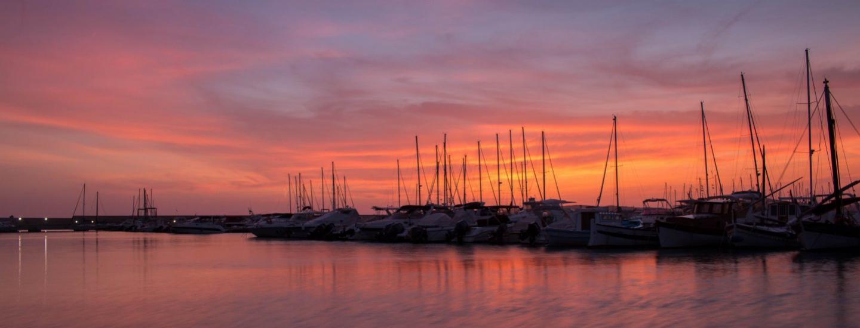Suggestivo tramonto sul porto