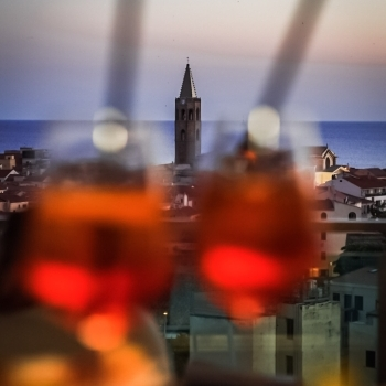 Aperitif with the bell tower in the background