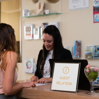Receptionist welcomes a guest