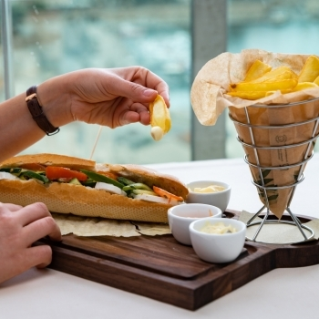 Sandwich with vegetables and fries